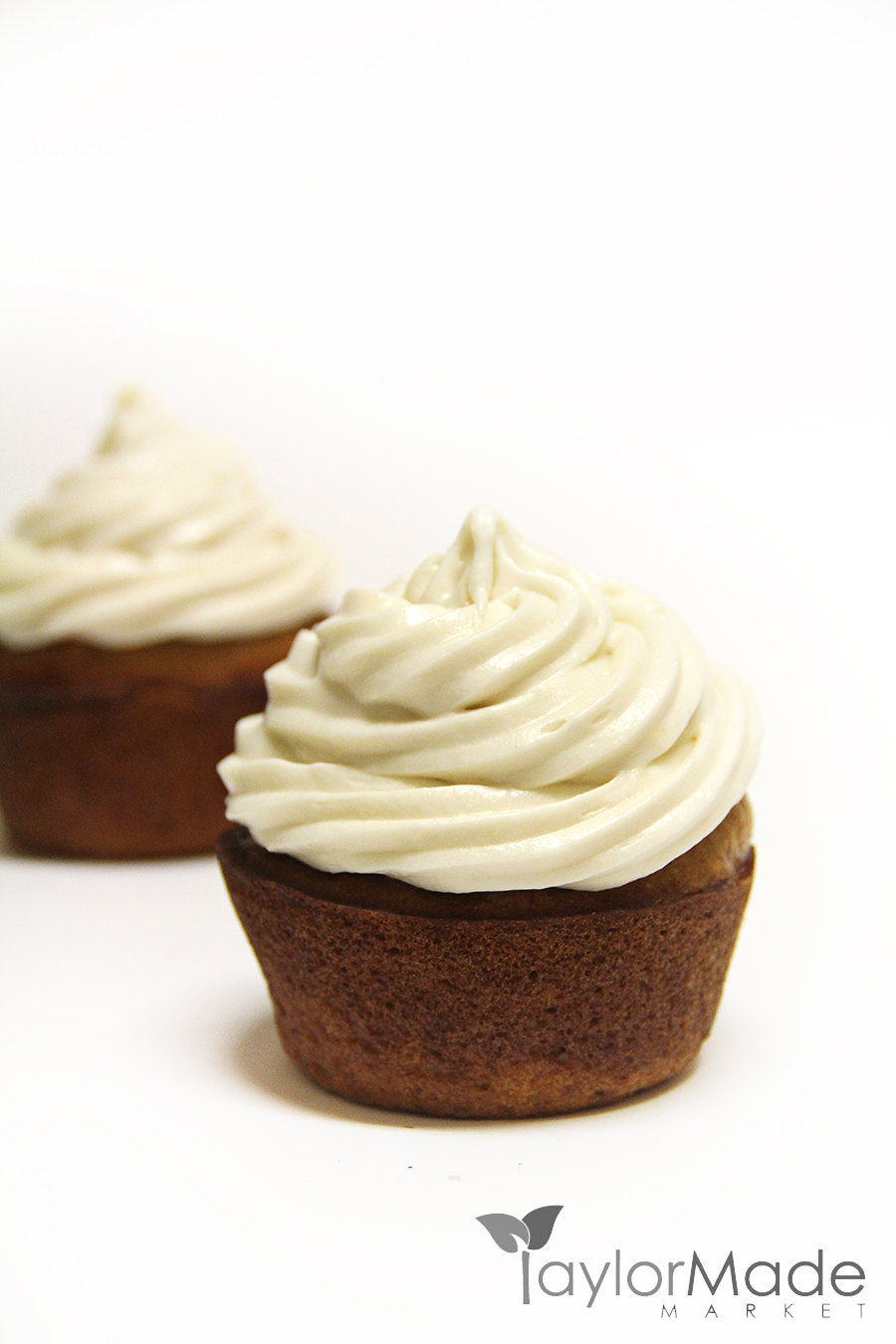 cupcake frosted on white vertical