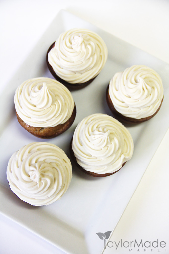cupcakes with frosting on white vertical