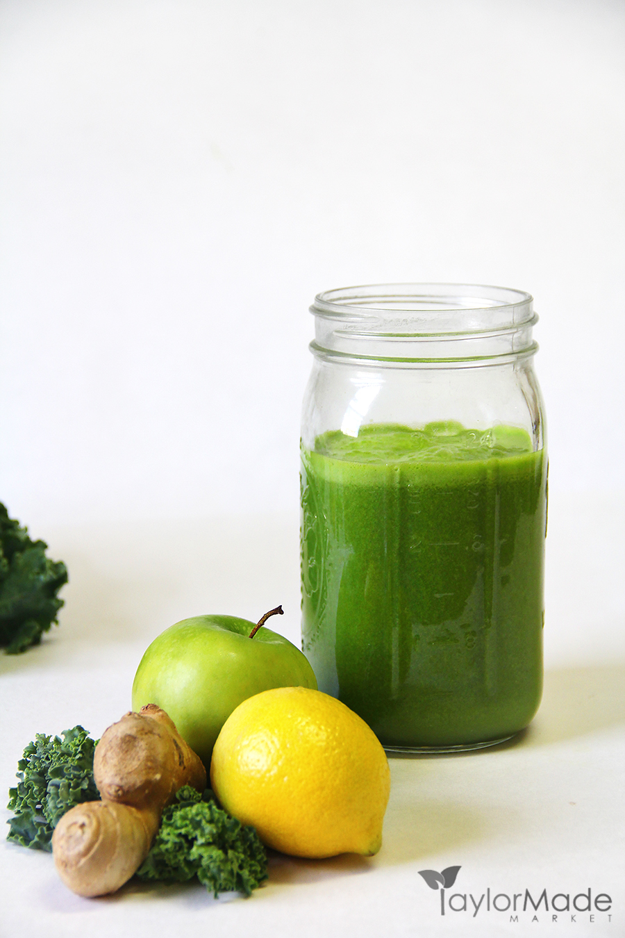 Kale apple lemon ginger juice vertical