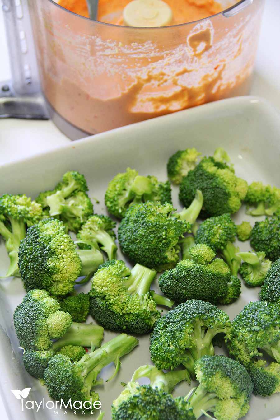 Broccoli and raw vegan cheeze sauce vertical