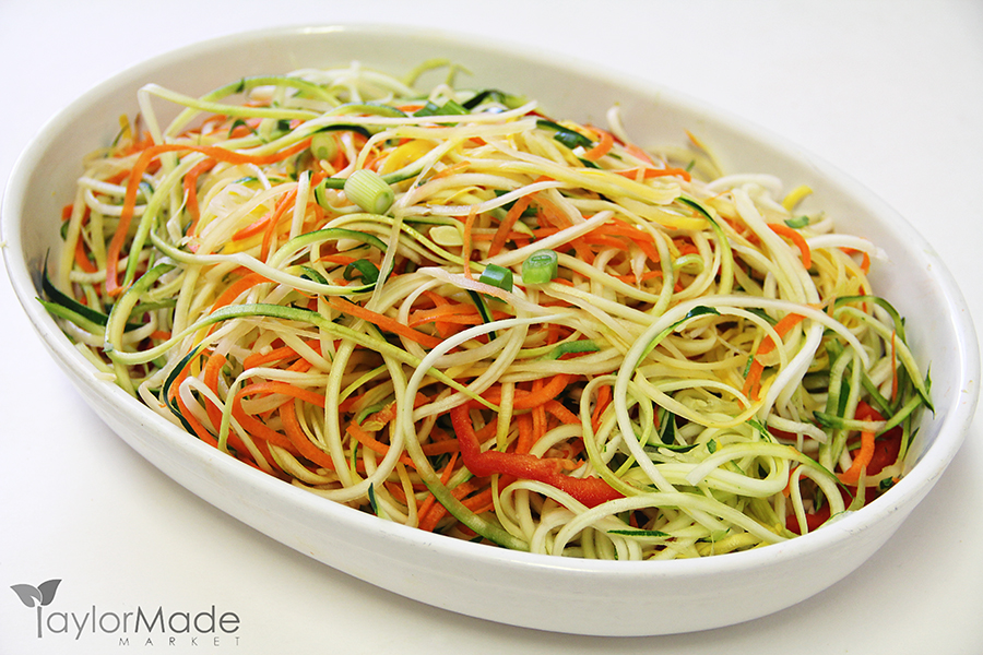 vegetable noodles in a bowl on white
