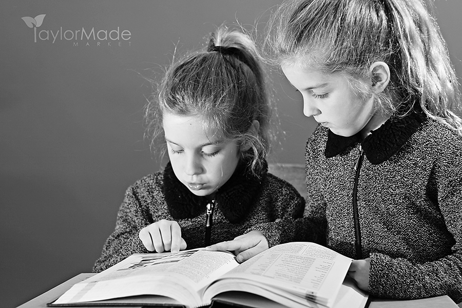 shot of Two little girls studying together