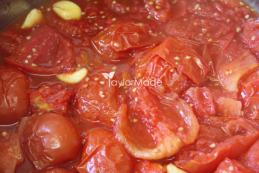 tomatoes cooking for sauce