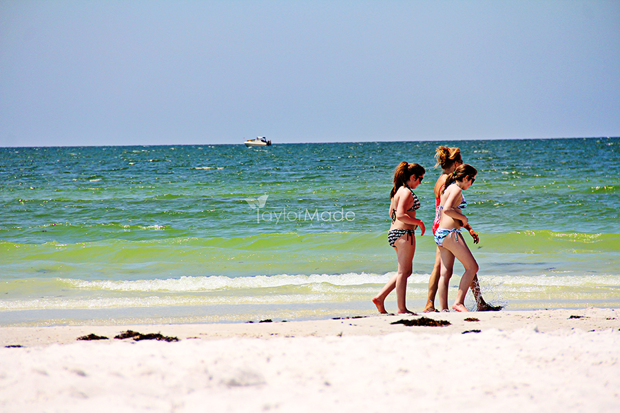 girls walking on the beach